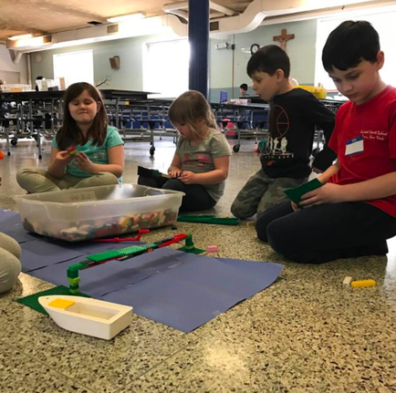 childcare program in Albany: kids working on a creative project together